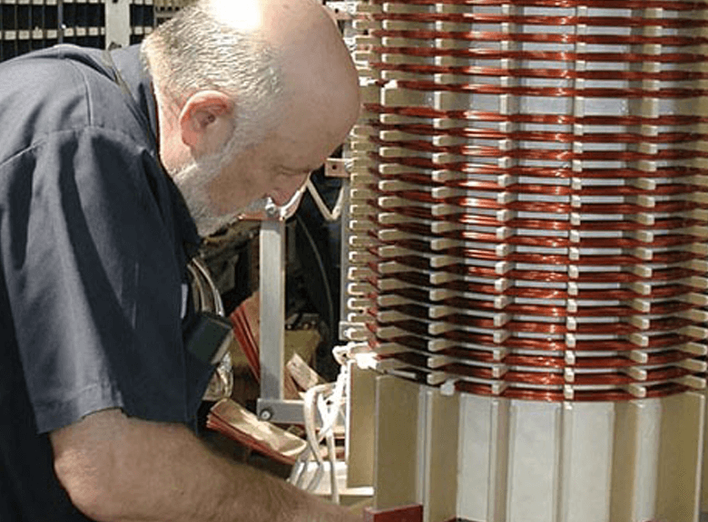 Technician working on a dry type transformers coils.