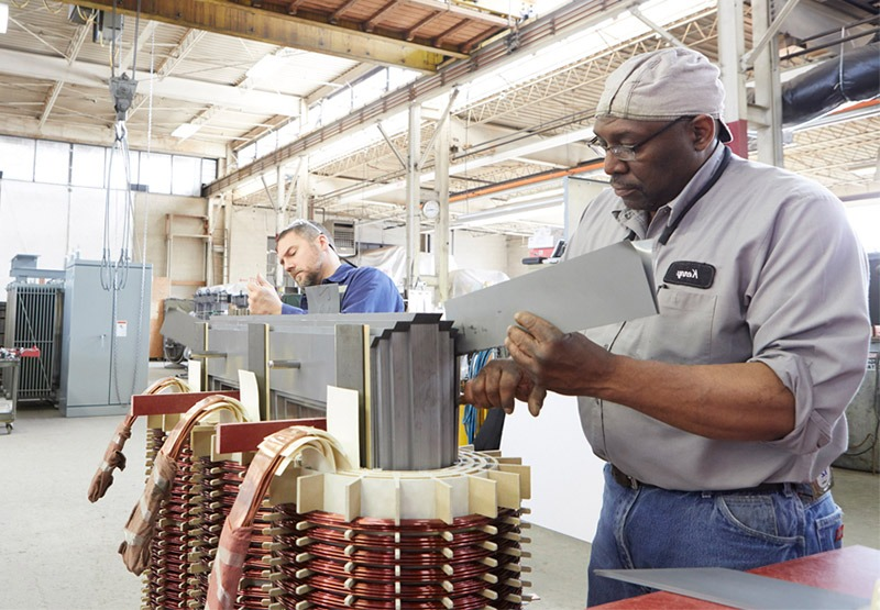 Two ELSCO technicans working on a dry type transformer.